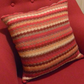 Pillow with lifted stiches