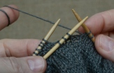 Step 2: Place the needle in front (for right side of the sleeve keep it on the back)