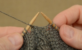 Slip the middle stitch over to the left needle.