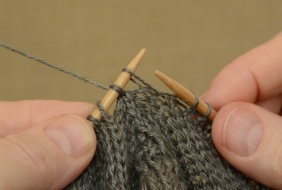 """Slip the first stitch from the """"front"""" stitches over to the left needle."""