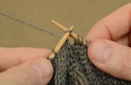 Slip the two stitches to the right needle.