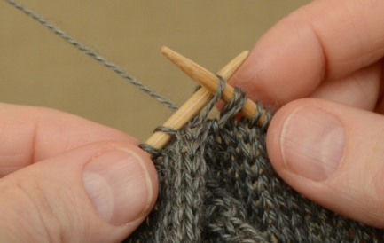 """Slip the first stitch from the """"back"""" needle to the right needle."""