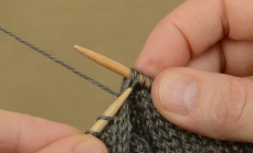 """Now you have the middle stitch in front of one stitch from the """"front"""" and one from the """"back"""" stitches."""