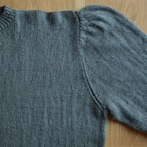 A combination of raglan and decreasing multiple stitches at the same time.